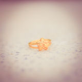 Love gold ring put on ground vintage style Stock Photos