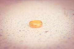 Love gold ring put on ground vintage style Royalty Free Stock Photos