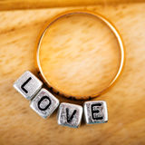 Love and golden ring Stock Image