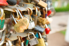 Love golden romance lock. With heart shape on the bridge Royalty Free Stock Image