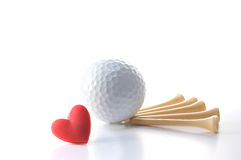 Love Golf. Isolated white golf ball with wooden tees on white with red heart. Concept Father's Day theme incorporating I love golf message. Copy space stock photos