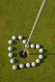 .Love Golf so much. Love Golf so much.It comes with seventeen balls in a heart shape Royalty Free Stock Photos