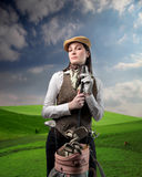 Love golfing. Portrait of a woman holding a golf club in her hands in a green lawn Stock Images