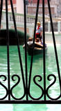 Love on a Gondola. A gondolier takes a couple on a ride stock photo