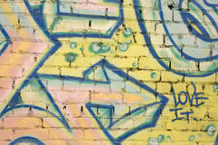 Love it graffitti. Graffitti on brick wall with arrow pointing to love it Royalty Free Stock Photo