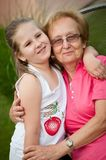 Love - grandmother with granddaughter portrait Royalty Free Stock Image