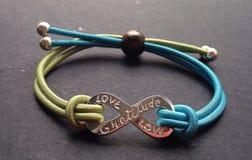 Love & Gratitude bracelet Stock Photography