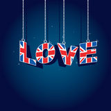 Love great britain. Hanging united kingdom love decorations on blue background Stock Image