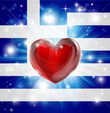 Love Greece flag heart background. Flag of Greece patriotic background with pyrotechnic or light burst and love heart in the centre Royalty Free Stock Photography