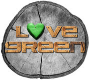 Love Green on Section of Tree Trunk Royalty Free Stock Image