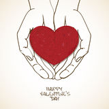 Love greeting card with human hands holding knitted heart Stock Photography