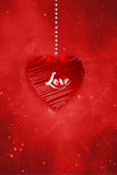 Love  Greetings. Red  heart hanged with dots and tied with red lace on blue glittering background Stock Image