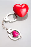 Love in handcuffs Stock Photography
