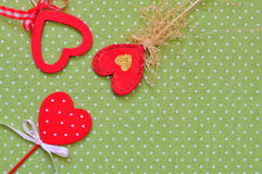 Love handmade hearts on green texture background, valentines day card concept Stock Image