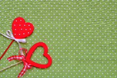 Love handmade hearts on green texture background, valentines day card concept Stock Photos