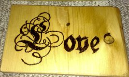 Love. Handmade Wood burned sign royalty free stock photography