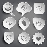 Love in hands, protection love, careful heart, unrequited love,. Atomic heart, heart and arrow, closed heart. White  buttons on gray Stock Photo