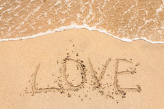 Love handwritten in sand for natural Stock Image