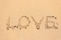 Love handwritten in sand for natural Royalty Free Stock Images