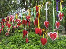 Love Hanging From a Chain. Lovers hang hearts together at Butterfly Spring in the Dali region of Yunnan, China Stock Photo