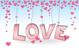 LOVE - hanging pink letters with hearts Royalty Free Stock Photo