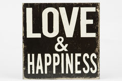 Love and Happiness sign. Love and Happiness on vintage rustic painted sign Royalty Free Stock Photos