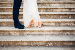 Love and happiness on wedding day. Closeup of bride`s and groom`s feet Royalty Free Stock Photos