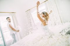 Love happy couple in the bedroom with feathers stock photo