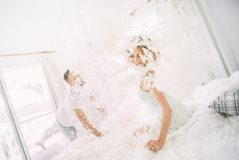 Love happy couple in the bedroom with feathers stock photography