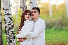 Love, happy couple in park with birch trees, summer, autumn suns Royalty Free Stock Photos