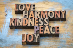 Love, harmony, kindness, peace and joy. Inspirational word abstract in vintage letterpress wood type Stock Image