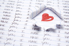 Love and hate. Some hand writting saying i hate you. Red heart hand drawing Stock Image