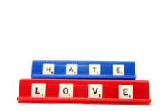 LOVE and HATE. Scrabble pieces spelling the words LOVE and HATE Stock Photos