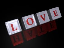 Love and Hate - 3D image. Love reflecting Hate on shiny cubes and a black background - 3D image Stock Photography