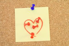 Love-hate note. Corkboard with a love - hate message stock photos