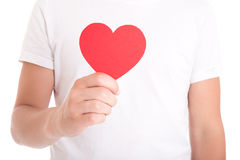Love or health care concept - man holding red paper heart Stock Photo