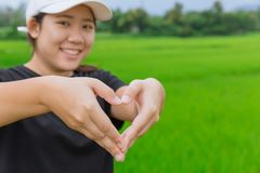 Asian teen show hand heart sign Royalty Free Stock Images