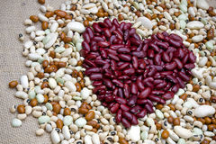 Love healthy eating. Heart shape symbol made from kidney beans stock photo