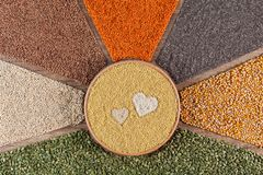 Love healthy food concept with diverse grains, seeds and various cereals royalty free stock photo