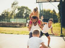 They love a healthy life. Family playing basketball royalty free stock images