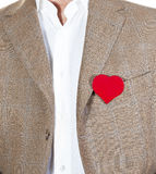 Love heart. Man in brown jacket with a red heart on the jacket, place for words in herat Royalty Free Stock Image