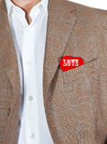 Love heart. Man in brown jacket with a red heart in the pocket with the word love Stock Image