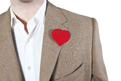 Love heart. Man in brown jacket with a red heart on the jacket, place for words in herat Stock Images