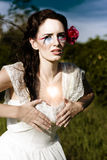 Love And Heart Ache. Is A Desire Filled Woman Pressing Against Her Chest Outdoors In A Romantic Image Of Longing Craving And Yearning Stock Photo