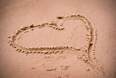 Love heart in the beach sand Stock Photography