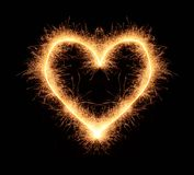 Love heart of bengali spakles drawn on black background. Bright romantic love heart drawn with sparkles isolated on black background Royalty Free Stock Image