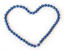 Love, heart. Blue necklace on a white background Stock Photo