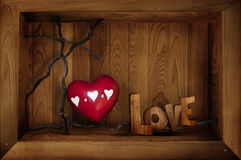 Love with heart. A box containing a red heart and the word love.  Valentines day concept Stock Image