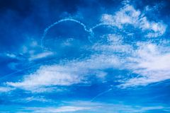 Love heart cloud drawing by airplane on airshow. Love concept for travelling the world.  stock photography