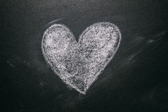 Love Heart Drawing On A School Chalkboard. Handwritten Message On A School Chalkboard Drawing With An Illustrated Heart. Used As A Symbol, Concept Of Love In royalty free stock images